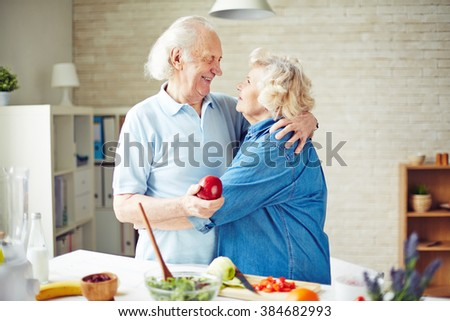 Family of two enjoying each other while cooking - stock photo