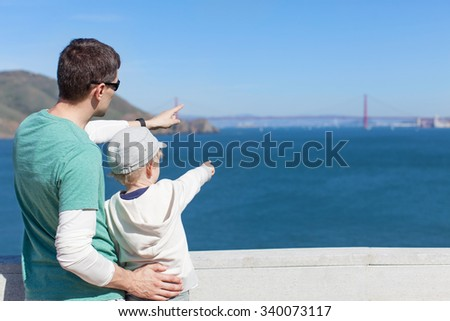family of two enjoying the view of famous golden gate bridge and san francisco in california - stock photo