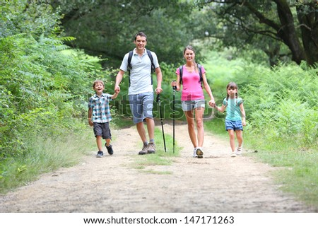 Family on a trekking day in countryside - stock photo
