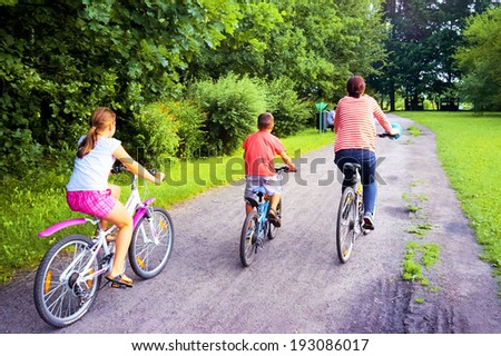 Family on bicycles in the spring Park - stock photo