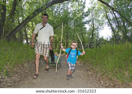 family on hike in park - stock photo