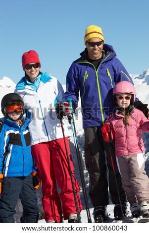 Family On Ski Holiday In Mountains - stock photo