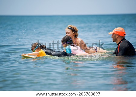 Family on surf - stock photo
