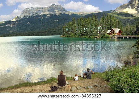 Family on the bank of Emerald lake (Yoho National park. Alberta. Canada) - stock photo