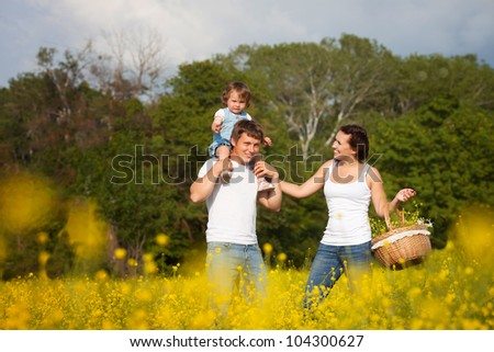 Family on the flower meadow - stock photo