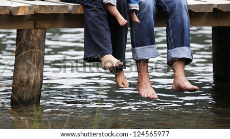Family on the pontoon - stock photo