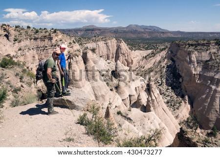 Family on the top of the mountain. Kasha-Katuwe Tent Rocks National Monument, Cochiti, NM, USA - stock photo
