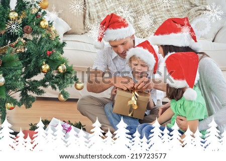 Family opening christmas gifts sitting on the floor against fir tree forest and snowflakes - stock photo
