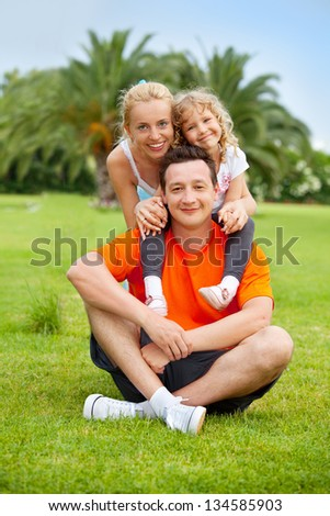 Family outdoor in summer park - stock photo