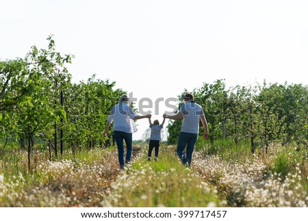 Family outdoor recreation. The little boy and parents have a rest on a meadow. - stock photo