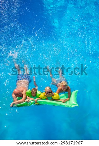 Family Outside Relaxing In Swimming Pool on a lilo - stock photo