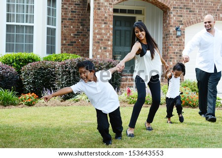 Family outside together on a nice day - stock photo