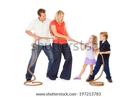 Family: Parents Versus Children In Tug Of War Game - stock photo