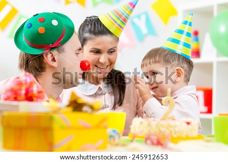 family play game celebrating child birthday at home - stock photo