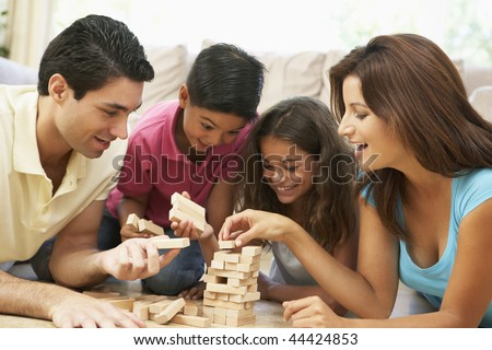 Family Playing Game Together At Home - stock photo