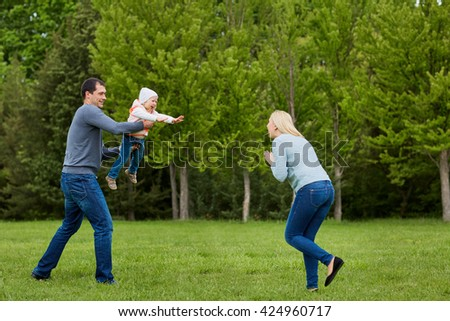 Family playing in the park. - stock photo
