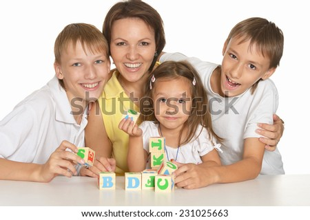 Family playing with cubes isolated on white - stock photo