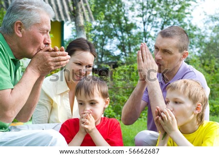 family plays in the summer park - stock photo