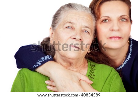 Family portrait - happy daughter and her old mother - stock photo