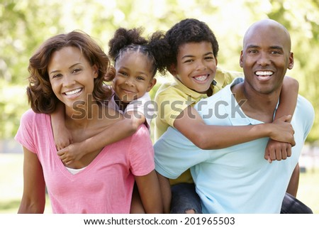 Family portrait in park - stock photo