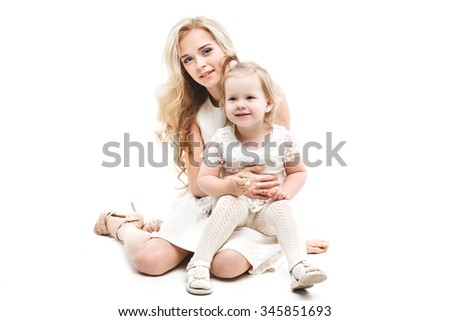 Family portrait. Mother hugging daughter. White background isolated. - stock photo