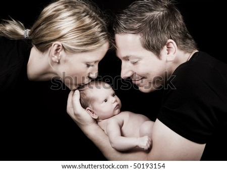 Family portrait of a twenty days old baby and his parents - stock photo