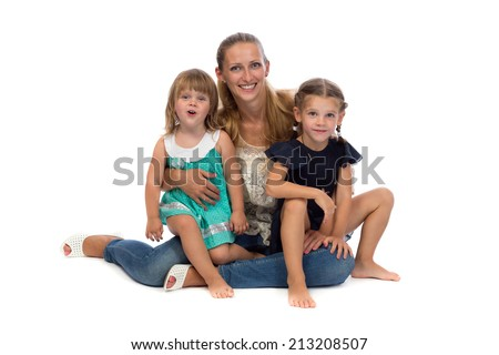Family portrait of a young mother and two daughters, isolate on white background. - stock photo