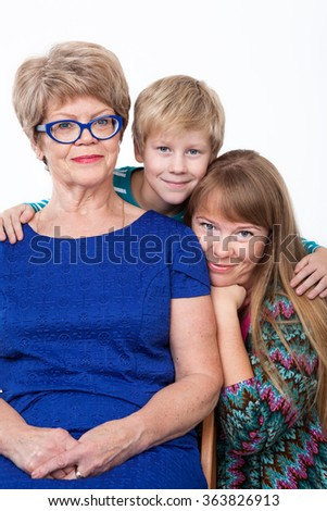 Family portrait of an senior grandmother, adult mother and young son on a white background - stock photo
