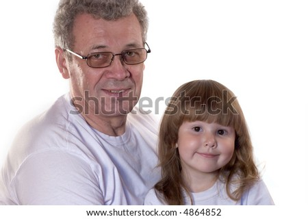 Family portrait of grandfather and granddaughter in white t-shirts isolated on white - stock photo