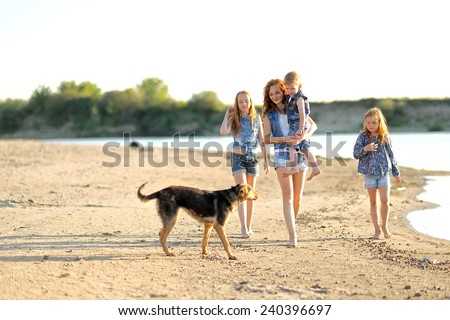 family portrait of mother and of a boy and his two sisters loved - stock photo
