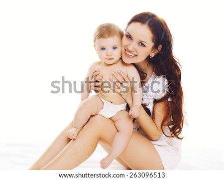 Family portrait of smiling mother with baby in diapers - stock photo
