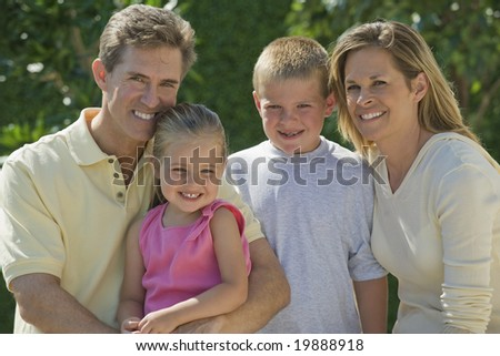 Family portrait outdoors - stock photo