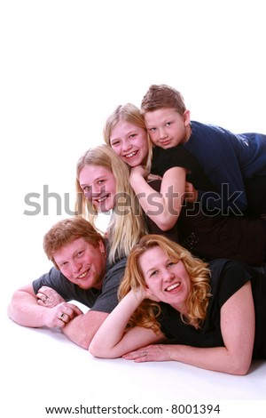 Family portrait with kids piled on dad - stock photo