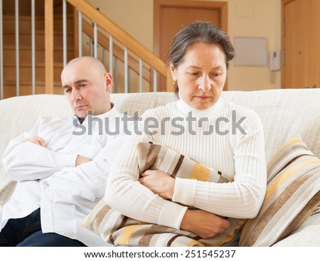 Family quarrel. Woman having problems with her husband at home - stock photo