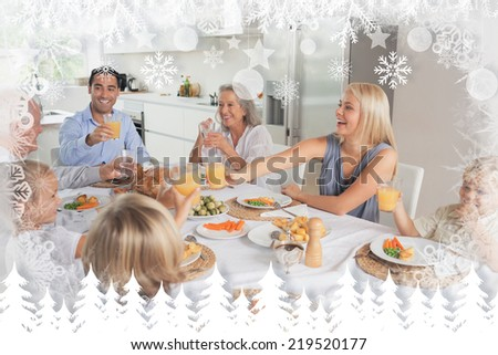 Family raising their glasses together against fir tree forest and snowflakes - stock photo