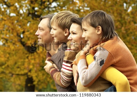 family relaxing in a beautiful autumn park - stock photo
