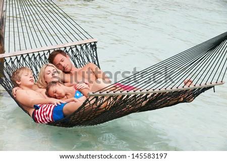 Family Relaxing In Beach Hammock - stock photo
