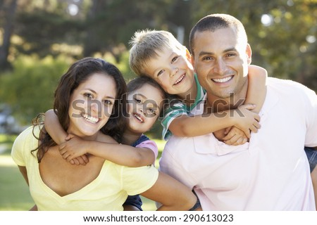 Family Relaxing In Summer Park - stock photo