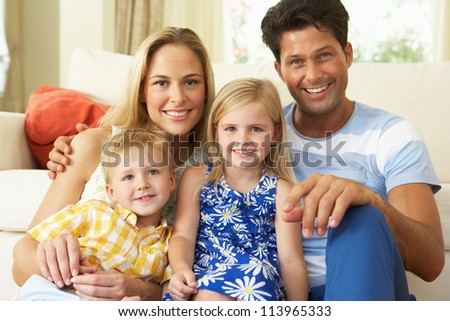Family Relaxing On Sofa At Home - stock photo