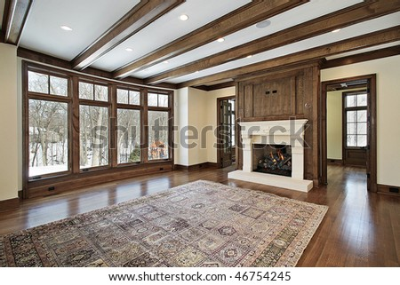 Family room in new construction home with wood ceiling beams - stock photo