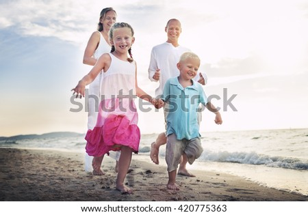 Family Running Playful Vacation Travel Holiday Concept - stock photo