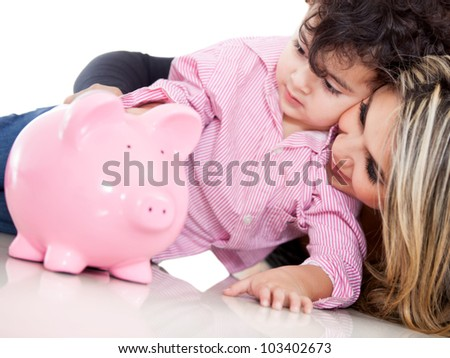 Family saving in a piggybank - isolated over white - stock photo