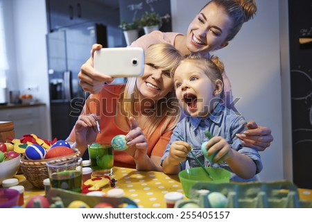 Family selfie with easter eggs - stock photo