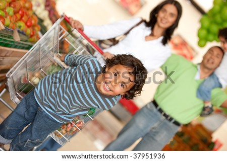 Family shopping for some groceries at the supermarket - stock photo