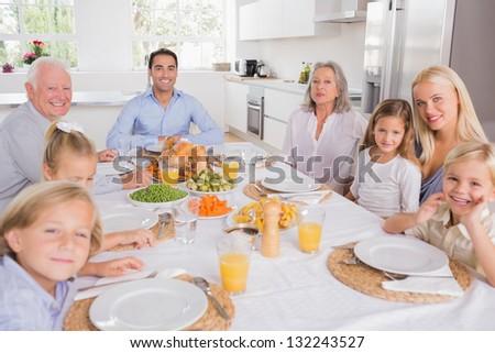 Family sitting for thanksgiving dinner - stock photo