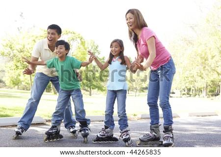Family Skating In The Park - stock photo