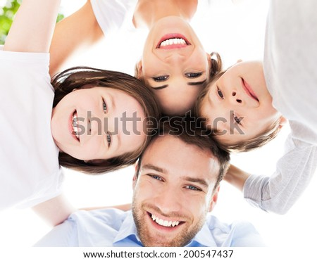 Family smiling together outdoors - stock photo