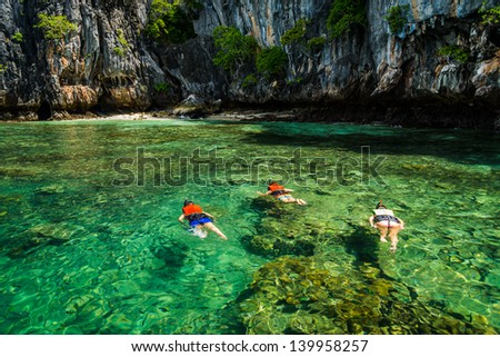 Family snorkeling on the Gulf of Thai , Thailand. - stock photo