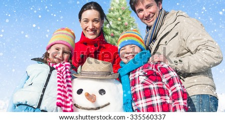 Family Standing Around Snowman And A Christmas Tree Concept - stock photo
