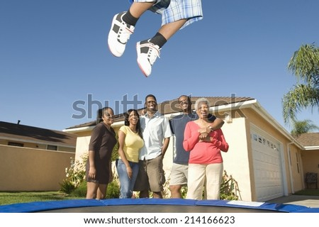 Family standing outside a house - stock photo